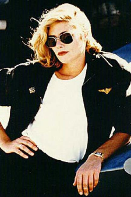 While Tom Cruise in <em>Top Gun</em> (1986) is definitely the more famous sunglasses-wearing cast member, Kelly McGills was absolutely babe-ing.