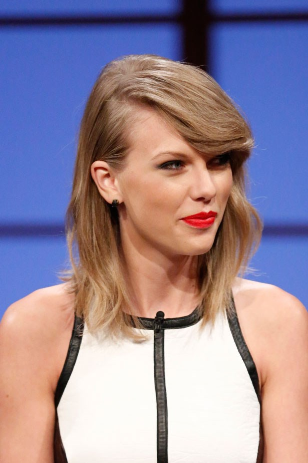 During a television interview, Swift wore this vivid orange-y red lipstick.