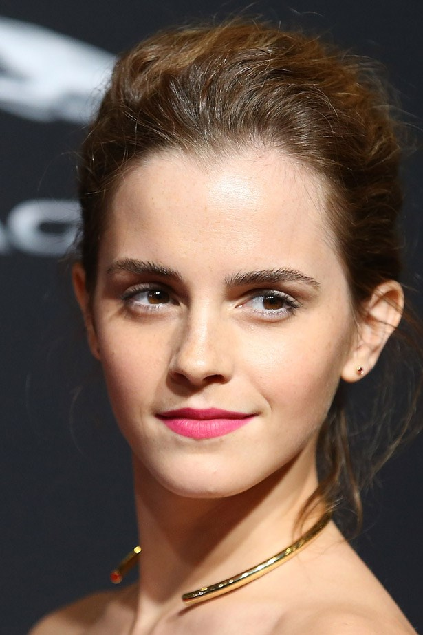 Emma Watson wearing gold jewellery