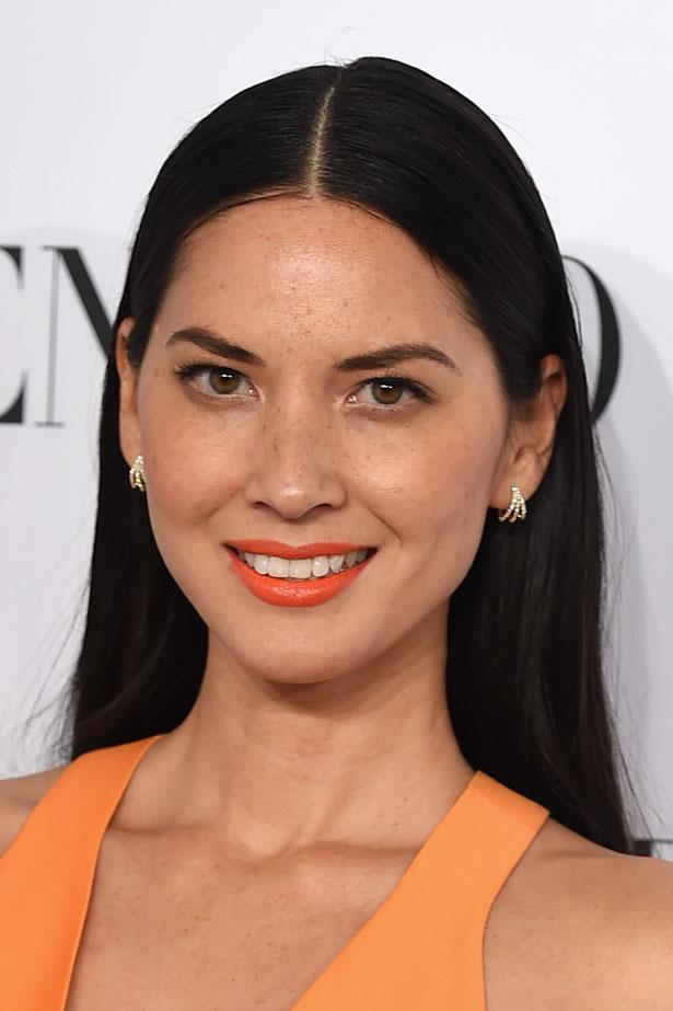<p>Protect your look from humidity and heat by slicking strands down and keeping the rest of your makeup simple – sans an eye catching colour on your lips.</p> <em>Olivia Munn</em>