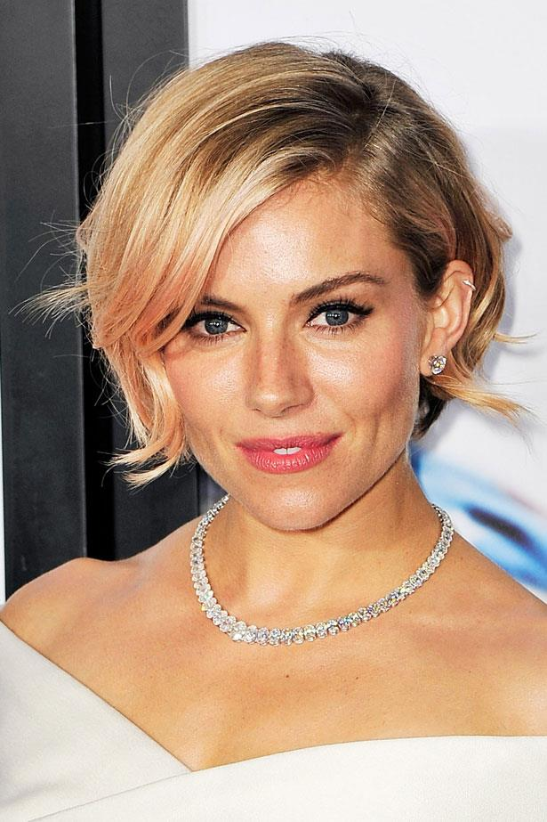 <p>Dress up black kohl liner with a your-lips-but-better peachy stain and a sheer wash of pink in your hair. </p> <em>Sienna Miller </em>