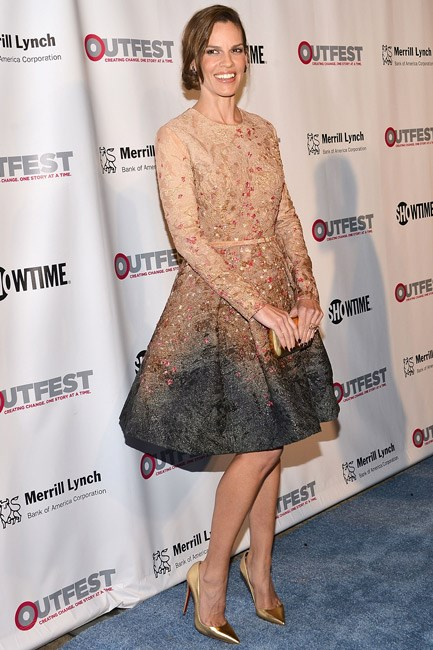 Proving that demure can also be alluring, Hilary Swank in a long-sleeved Elie Saab couture dress.