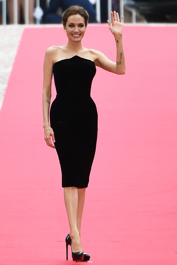 Angelina Jolie <br> Wearing: Atelier Versace dress and Saint Laurent shoes <br> Where: <em>Maleficent</em> premiere in Japan