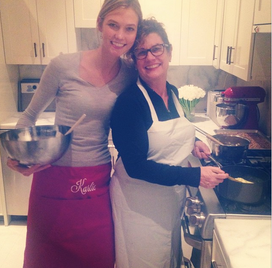 """<strong>Karlie Kloss</strong><br> Victoria's Secret model and expert baker Karlie Kloss posted this adorable shot of her and her mum cooking up a pre-Christmas feast. """"Every year before the holidays, my mom and I devote an entire day to spend in the kitchen together, baking up holiday goodies for friends, family and loved ones. These goodies are made with a LOT of Love"""" Cute. <br><br> Instagram: @karliekloss"""
