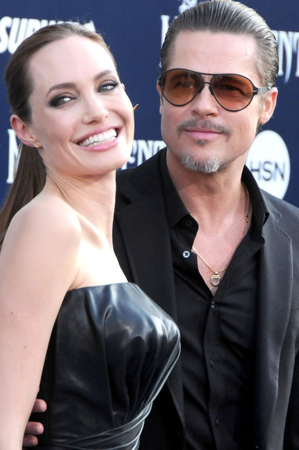 """<strong>Angelina & Brad Tie The Knot</strong><br> Dressed in a simple white silk gown, Angelina Jolie finally walked down the aisle to her parter of close-to ten years, Brad Pitt - something many assumed would never actually happen. The  wedding took place in France and her dress was designed by good friend Luigi Massi, also the head tailor at Atelier Versace. The best part was that her veil was adorned with little drawings from the Brandgelina brood. Cute. <br><br> Related links:<br> <a href=""""http://www.elle.com.au/news/celebrity-news/2014/9/see-angelina-jolies-wedding-dress-in-all-its-simple-glory/"""">See Angelina Jolie's wedding dress in all it's simple glory.</a>"""