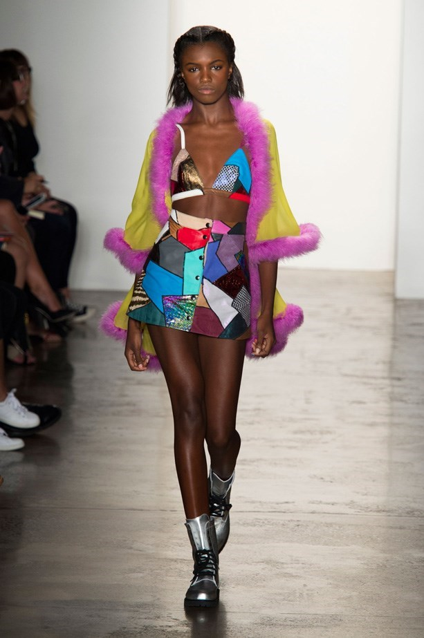 """<strong>Venue: A Warehouse Rave</strong><br> Kicking it at a warehouse rave, anything goes, obviously. Sheer fabrics, neon, fur, patchwork and metallic are all on point here. So take some style notes from this season's most colourful looks, such as Moschino's acid Barbie cropped set, Peter Pilotto's metallic mini dress and Jeremy Scott's patchwork bikini top, A-line skirt and fur-trimmed cape.  And if those are a bit too festive, there's always Balmain's gothic and sexy deep-V jumpsuit that's made for an industrial setting. <br><br> <a href=""""http://www.elle.com.au/runway/ready-to-wear/ss15/2014/9/jeremy-scott-ss15/"""">Jeremy Scott SS15</a>"""