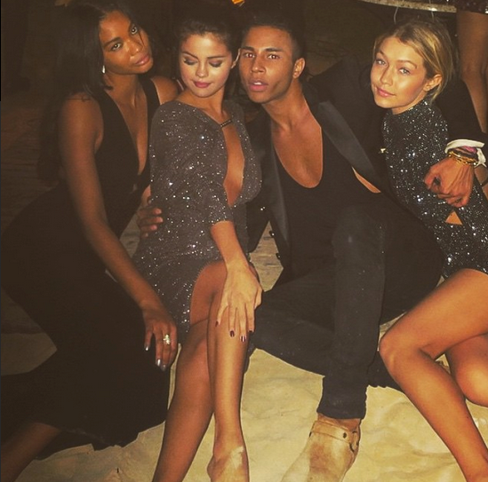 @selenagomez sparkled on the same beach with Chanel Iman, Olivier Rousteing and Gigi Hadid