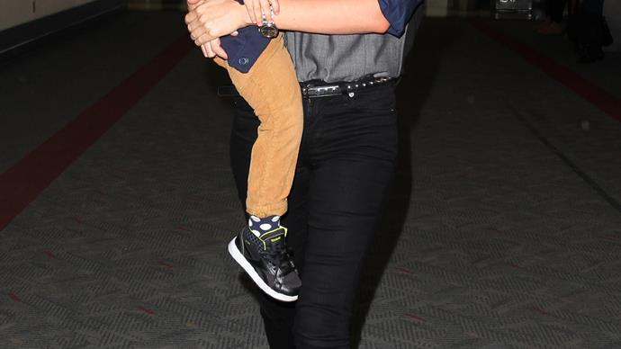 Miranda Kerr wearing Prada sunglasses