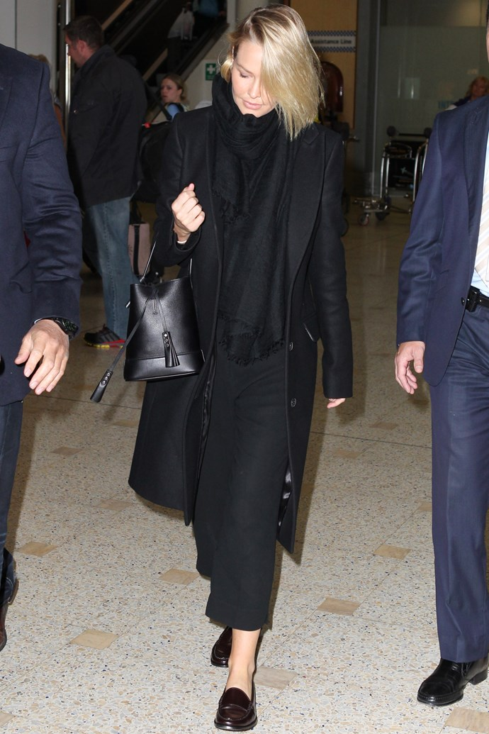 "<strong>Lara Bingle</strong> <br> Layers are the holy grail of air travel, and black-on-black-on-black makes them look effortless. <br><br> <em>Related: <a href=""http://www.elle.com.au/news/beauty-news/2014/11/elle-interviews-lara-bingle/"">ELLE interviews Lara Bingle</a></em>"