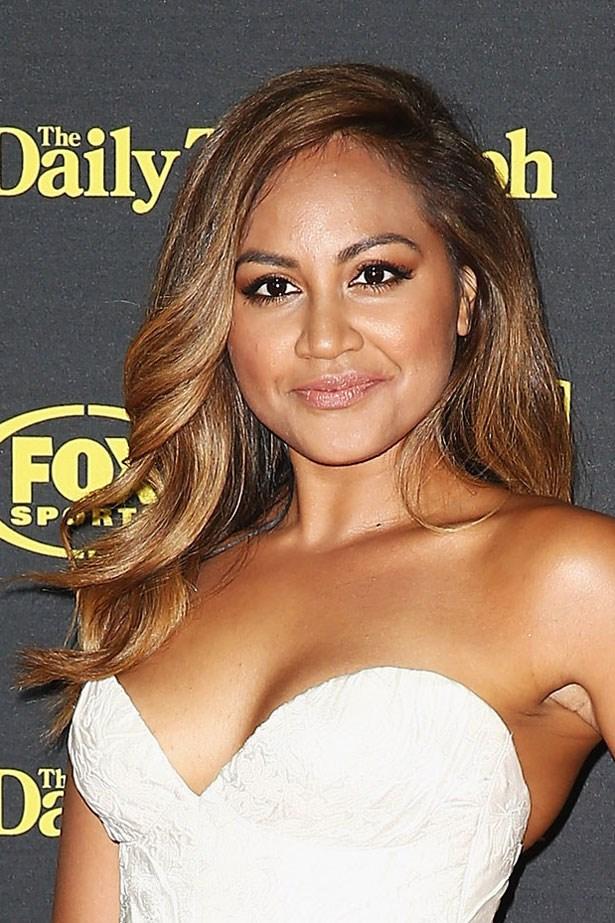 Voluminous curls and golden, bronzed skin enhanced Jessica's natural glow in September 2014.