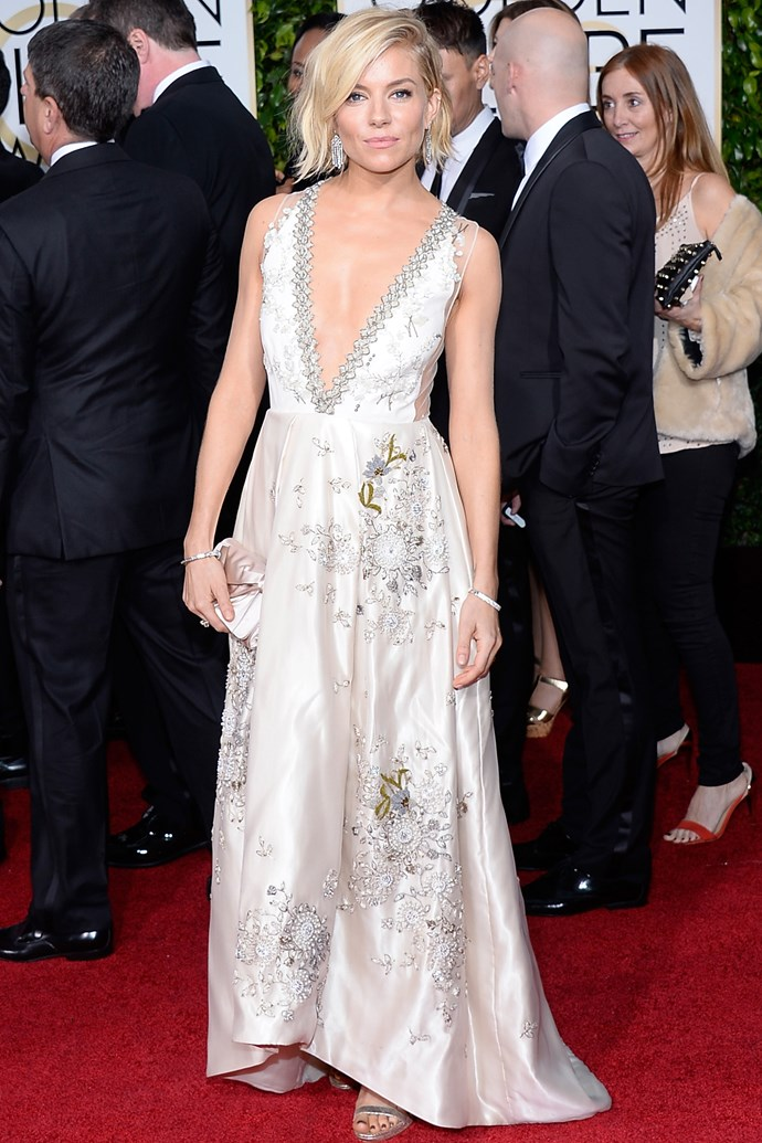 <strong>Sienna Miller</strong>'s Miu Miu number is garden party gone grown-up. Some décolletage action and I-woke-up-like-this messy bob keeps it fresh.