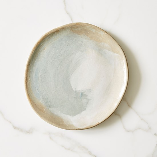 """A beautiful ceramic plate to eat off – this one was a Kris Kringle gift from our art director. <a href=""""http://www.harvestclay.com/ """">Plate, Harvest Clay, harvestclay.com</a>"""