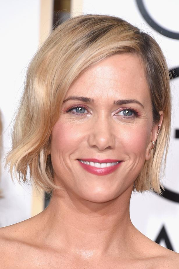 Luminous skin and a pink flush made Kristen Wiig's chin length bob glow.