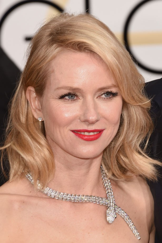 Naomi Watts' tousled hair is grounded by a classic red lip.