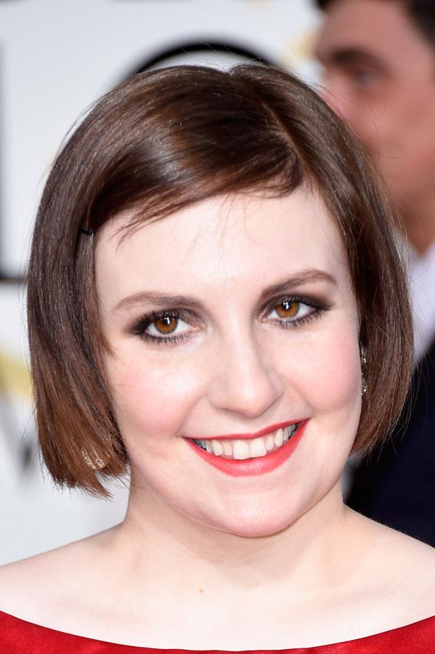 After a blonde spell last month, Lena Dunham is back to her brunette ways and wears a bronze smoky eye.