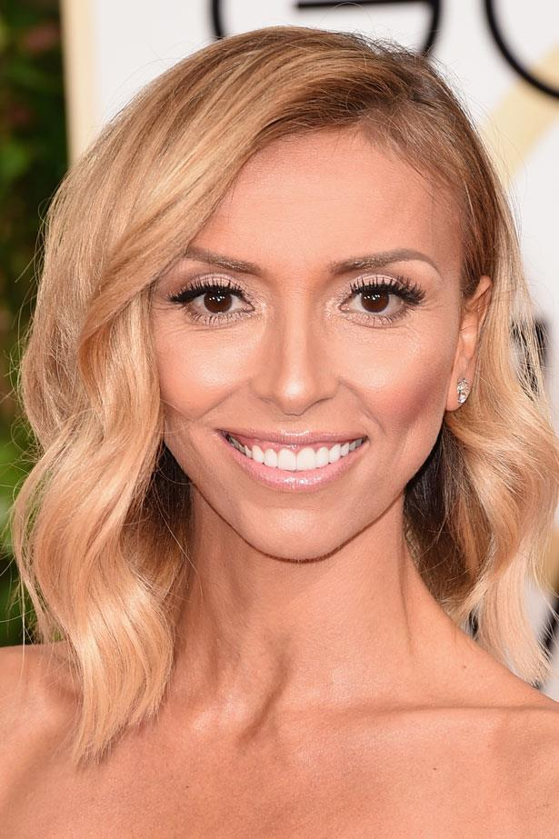 Giuliana Rancic combines soft waves and minimal makeup.