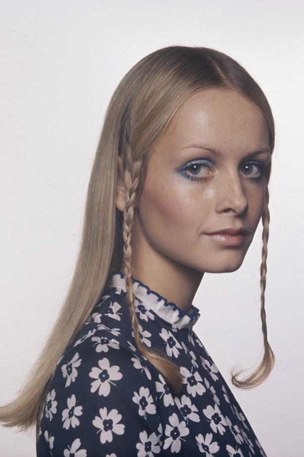 A fresh-faced Twiggy poses in a photoshoot with long hair, side braids and a rounded, blue shadowed eye in 1972, proving that though the mod trend was well and truly done, her youthful looks still transcended decades.