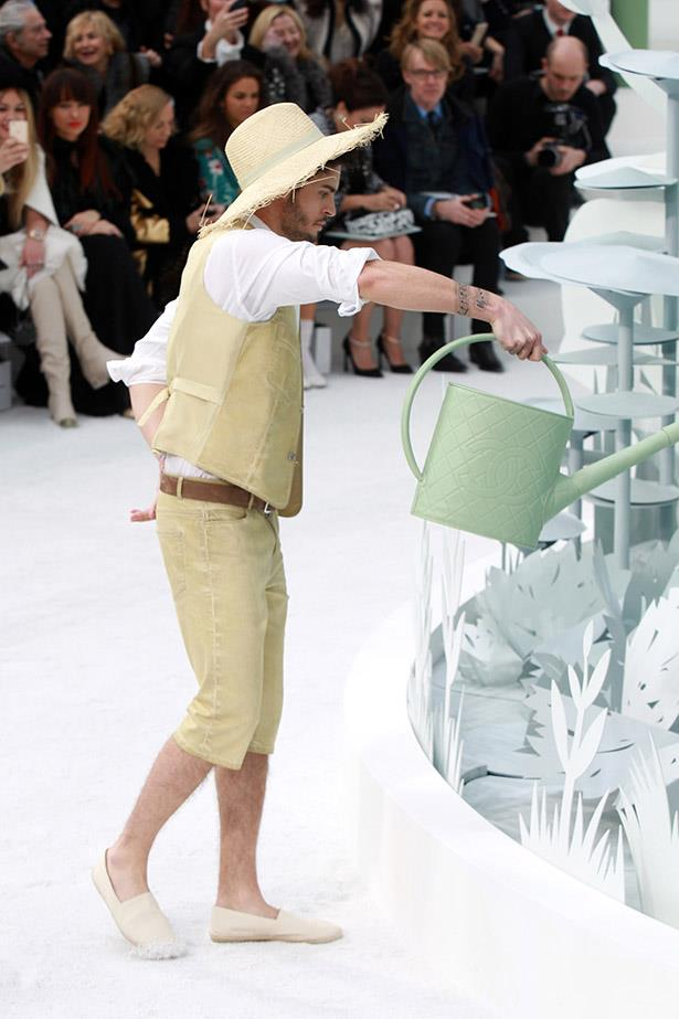 <strong>1 quilted watering can:</strong> Lagerfeld's muse Baptiste Giabiconi tended to the faux foliage with a quilted Chanel watering can, wearing a straw hat and cropped pants.