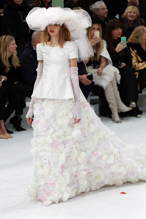 <strong>1 Chanel bride:</strong> In an exquisite train of beaded blooms and tulle.