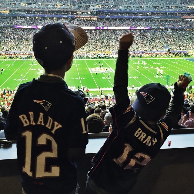 ...and then another of the mini Bradys cheering on their dad after kick off.