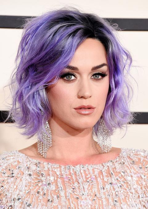 <strong>Katy Perry</strong><br> You didn't expect Katy Perry to stay with non-coloured hair for too long did you? After her Super Bowl performance sporting a long, black ponytail, she showed up at the Grammys with a purple, tousled bob. But it was her creamy complexion, cat eyeliner, and shimmery pout that really caught our eye.