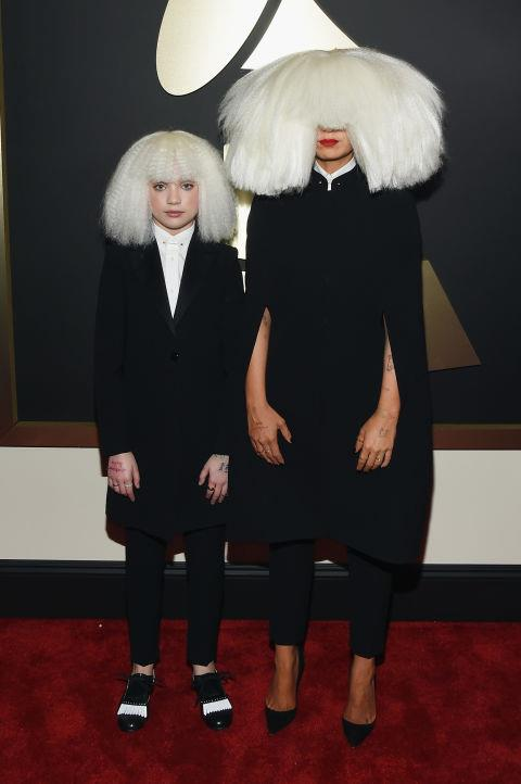 <strong>Maddie Ziegler and Sia</strong><br> Pint sized budding style icon Maddie Ziegler, dressed in Armani, accompanied Sia on the red carpet and made a big splash in the process. Maddie is no stranger to the spotlight but this look is a major step up in terms of maturity. We are even thinking of ways to copy this outfit for tomorrow.