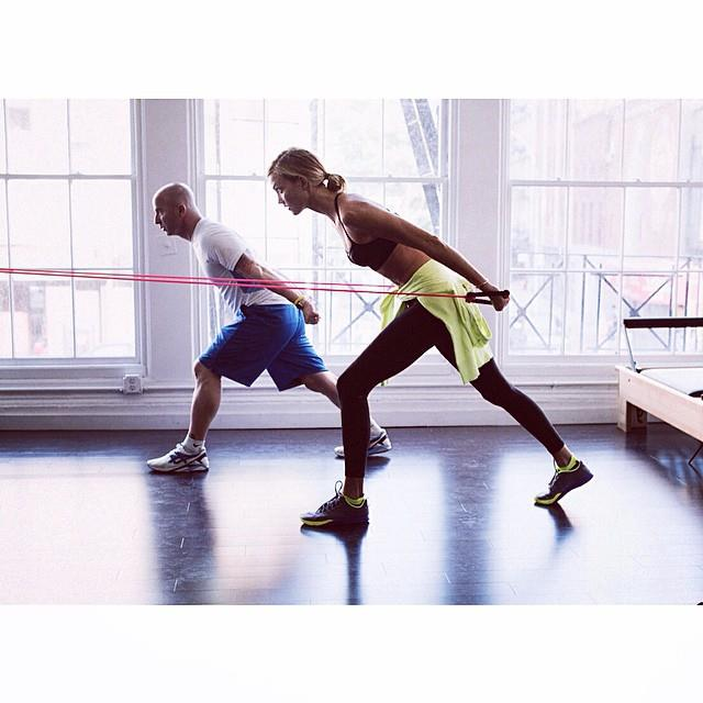 "<p><strong>Model:</strong> Karlie Kloss </p> <p><strong>Trainer:</strong> Justin Gelband from <a href=""http://www.modelfit.com/"">modelFIT</a></p> <em><p><a href=""http://instagram.com/modelfit"">@modelFIT</a></p></em>"