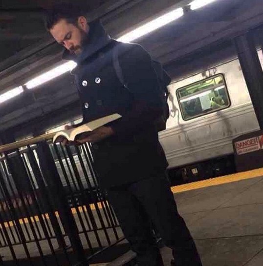 """""""Tall, dark and handsome with a thick beard AND a thick...book? This man must be straight out of the fiction section because he's too good to be true. If only he was patiently waiting for me instead of the E train. #YouKnowWhatTheySayAboutThickBooks #hotdudesreading"""" - @hotdudesreading"""