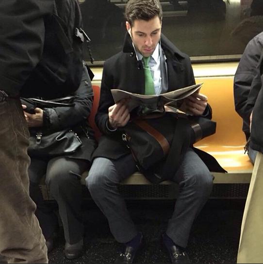 """Good morning, single bachelor. Nothing gives me more hope than a banker without a band. Almost has that dangerous Patrick Bateman vibe, but I can tell he's a nice guy on account of the black loafers and blue socks. He's probably listening to Taylor Swift in those headphones. #blankspace #hotdudesreading""  - @hotdudesreading"