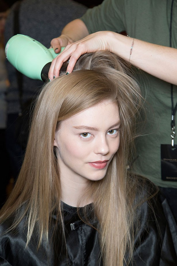 Souleiman says the process began with every model getting the extensions; stylists then parted the hair very precisely in a straight line on the side to give the look sophistication and sharpness.