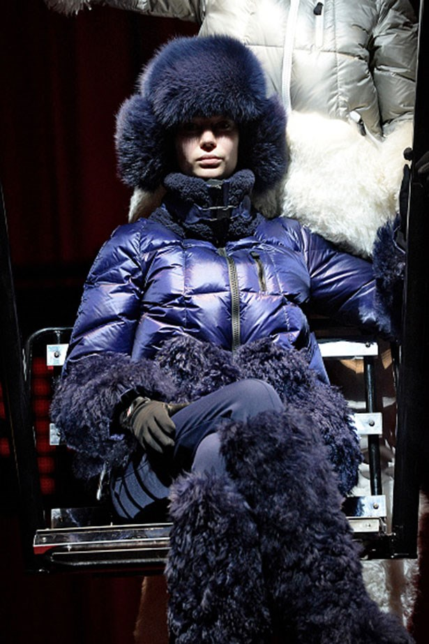 Moncler Grenoble, debuted their own version of next fall's puffer, which was a brightly tinted navy with shearling details.