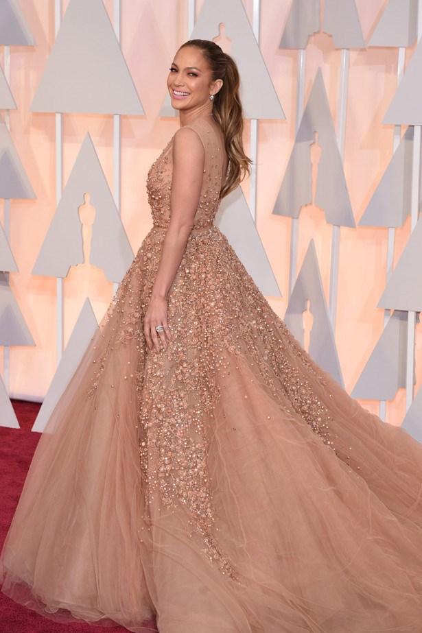 Jennifer Lopez wears a gown by Elie Saab