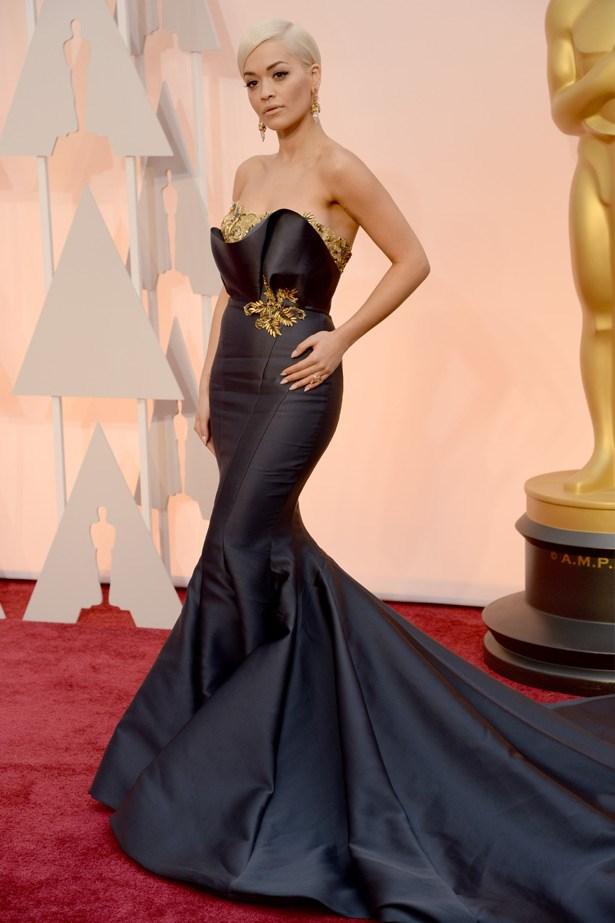 Rita Ora wears a navy gown by Marchesa