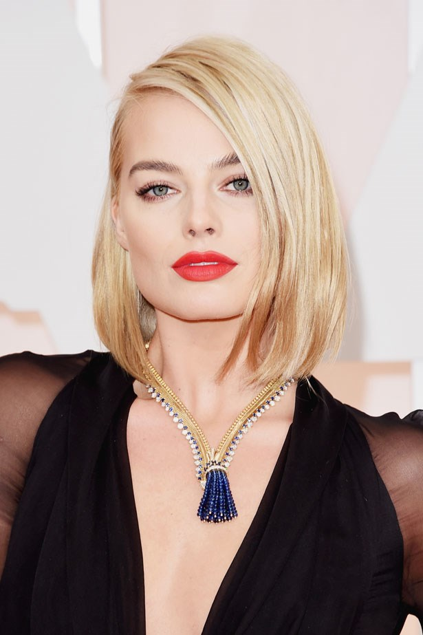 <p><strong>The Red Lip</strong></p> Margot Robbie wore the Opaque Rouge Liquid Lipstick and the Panoramic Lip Liner both in Raven from Hourglass Cosmetics.