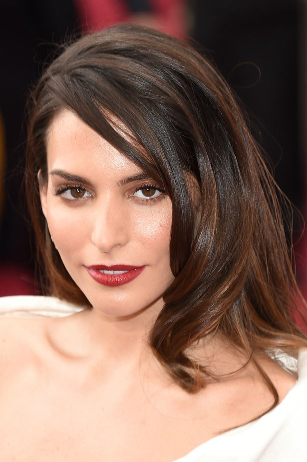 <p><strong>The Red Lip</strong></p> Genesis Rodriguez wore a classic dark tone red.