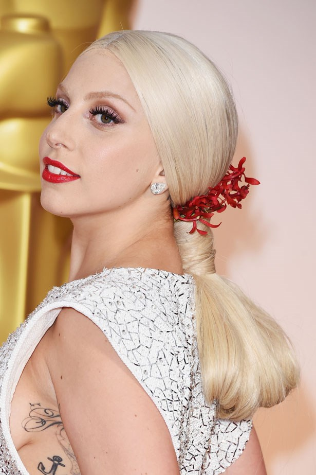 <p><strong>The Red Lip</strong></p> Lady Gaga wore a glossy lip.