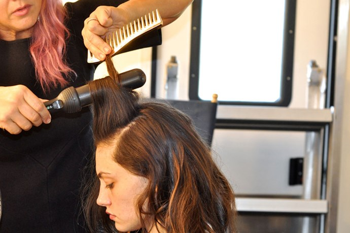 <p><strong>Step 4:</strong> Comb through the hair to break up the waves. Tip your head upside down and give the hair a good shake to add movement and volume.</p>