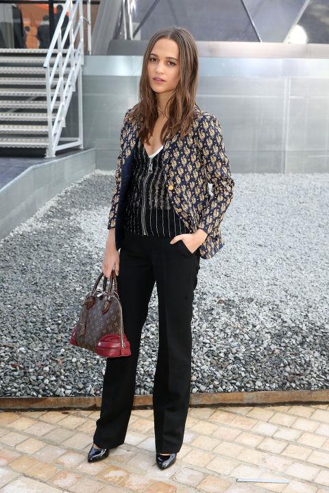 <strong>ALICIA VIKANDER</strong> At Louis Vuitton.