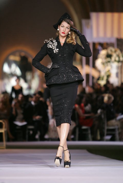 <strong>Dior Haute Couture Autumn/Winter 2008</strong><br> Gisele OWNED this 1940s-esque getup Dior's fall 2008 Couture show in Versailles. Killing it.