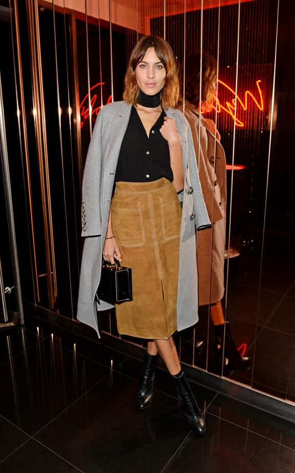 Alexa Chung wearing a Marks & Spencer suede skirt & Burberry Prorsum coat at the Rock the Empire party