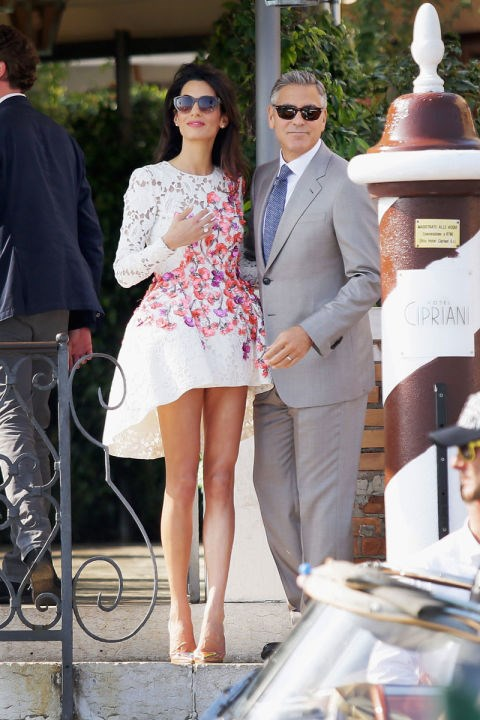 <strong>SEPTEMBER 28, 2014</strong> With George Clooney during her wedding weekend in Venice in a very chic floral number.