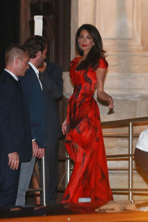 <strong>SEPTEMBER 26, 2014</strong> Lady in red, seen in Venice before her nuptials.