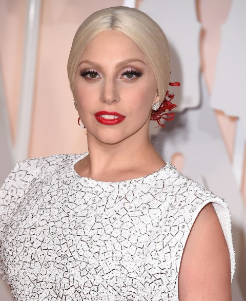 """<strong>LADY GAGA</strong> <BR> Gaga may only be in her late twenties, but she's all about giving herself a daily face lift using tape as her pick-me-up. """"I wash my face, I pin my hair back and put on a wig cap and I ask, 'How am I going to form my eyes today with this tape?"""" she told the <em>Mirror</em> newspaper. """"How will I pull back my neck with tape?'"""" <BR> <strong>The Verdict:</strong> We admire her creativity but have to file this one under: don't try <em>ever</em>. Your face and neck house your body's most delicate, wrinkle-prone skin so you don't want to be pulling at it too aggressively. But you can use Scotch tape for something else, occasionally: removing pesky glittery makeup. Just be gentle!"""