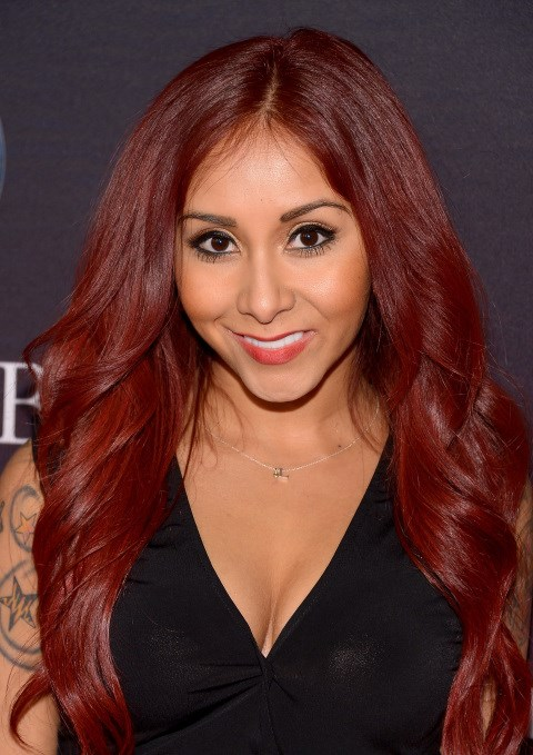 """<strong>NICOLE """"SNOOKI"""" POLIZZI</strong> <BR> The <em>Jersey Shore</em> star is infamous for many things, not the least of which is using a pet store staple as a natural exfoliant. """"Some exfoliants have rocks in them, and it makes your skin really smooth,"""" she explained during an interview with Conan O'Brien. """"Cat litter is like a substitute for that."""" <BR> <strong>The Verdict:</strong> We're all for a deep pore cleansing treatment, but worry that with rocky litter, you run the risk of over-exfoliating, which could cause permanent damage to the skin. Plus, eww?"""