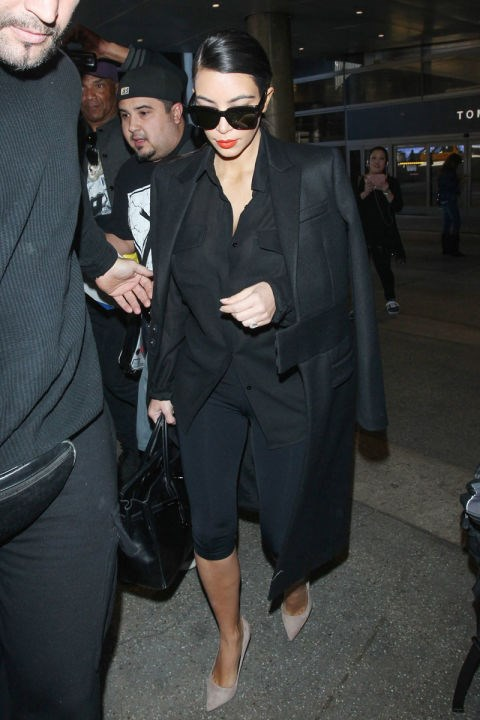 <strong>KIM KARDASHIAN</strong> <BR> Kim proves you can't go wrong in all black. Tired too? Throw on some shades.