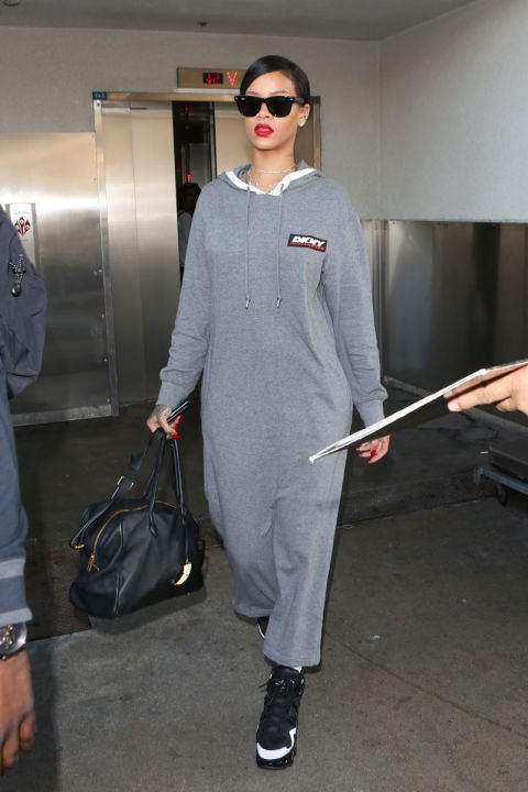 <strong>RIHANNA</strong> <BR> Best airport outfit of all time? Easily. Can't get more comfy than a full body sweatsuit dress.