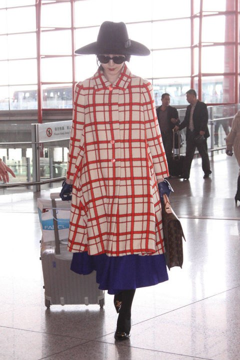 <strong>FAN BINGBING</strong> <BR> A statement coat at the airport? Why not?