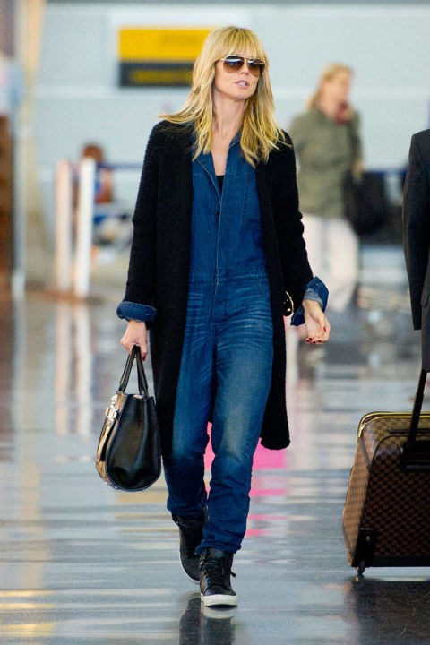 <strong>HEIDI KLUM</strong> <BR> A denim jumpsuit is a jet-setter's dream—chic and comfy.