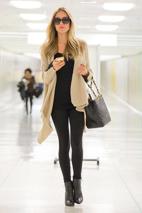 <strong>KRISTIN CAVALLARI</strong> <BR> Layer a neutral, chunky knit over black leggings for a sophisticated travel look—and a Chanel purse never hurts.