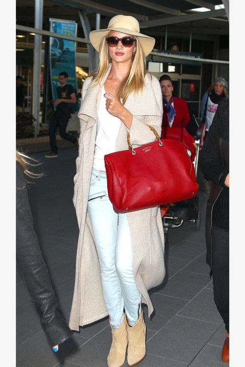 <strong>ROSIE HUNTINGTON-WHITELEY</strong> <BR> A statement bag in a bold hue is the perfect accent to layered neutrals.
